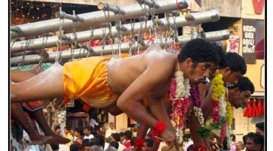 PAINFUL RITUAL! Watch Indians Hang Themselves With Rods To Serve Their Goddess 56
