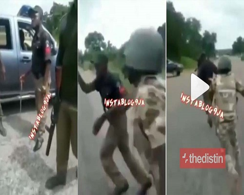 WATCH VIDEO: Soldiers Beat Up Policemen Extorting People In Nigerian Amid EndSars Protest 1